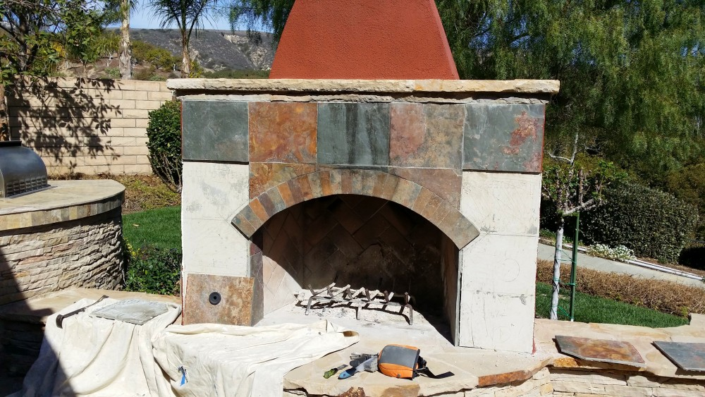 Re-tiling outdoor fireplace